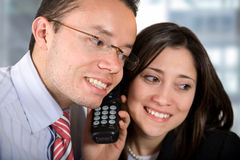 Business partners - good news on the phone Stock Images
