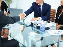 Business partners greet each other with a handshake at the begin stock photography