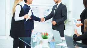 Business partners greet each other with a handshake before the p Stock Photo