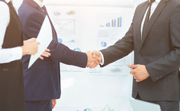 Business partners greet each other with a handshake before the p Royalty Free Stock Photos