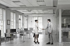 Business Partners Greeting Each Other . Mixed Media Royalty Free Stock Photos