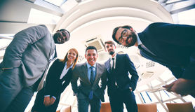 Business partners. Group of successful business people in suits looking at camera Royalty Free Stock Images