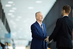 Business partners in Hall stock photos