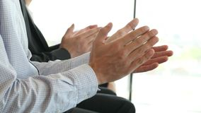 Business people applauding at meeting. Business partners hands applauding at meeting stock video footage