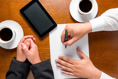 Business partners hands on the table Stock Photo