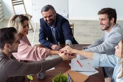 Business partners hands on top of each other symbolizing companionship. Business partners hands on top of each other symbolizing companionship royalty free stock photography