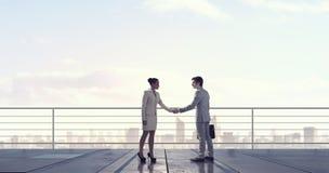 Business partners handshake . Mixed media Stock Photo
