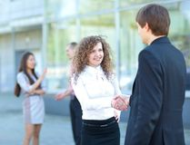 Business partners handshaking. After negotiating and signing contract Royalty Free Stock Photography