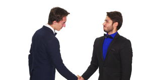Business partners handshaking while becoming tense - studio shot stock footage