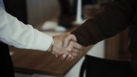 Business partners handshaking. Two man stock footage