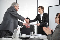 Business partners handshaking at meeting Stock Photography