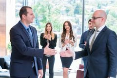 Business partners handshaking after signing contract. stock image