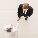 Business partners handshaking. Royalty Free Stock Photos