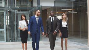 Business partners have a business meeting in a modern office building. Slow motion stock footage
