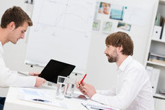 Business partners having a brainstorming session Stock Photo