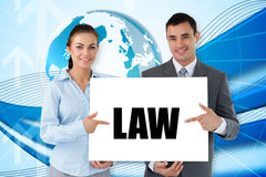 Business partners holding card saying law Royalty Free Stock Photography