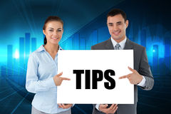Business partners holding card saying tips Stock Photos