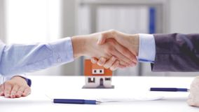 Business partners with house keys and contract stock video