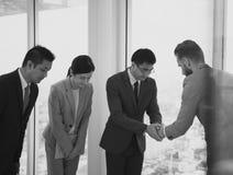 Business Partners Introductionary Handshake Bow Stock Image