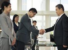 Business Partners Introductionary Handshake Bow Stock Photo