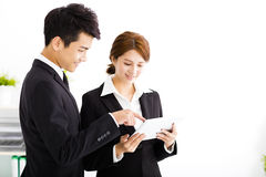 Business partners looking at  document in tablet Royalty Free Stock Photos