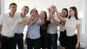 Business partners Make clinking glass with champagne in modern office space. On work stock footage