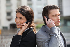 Business partners making calls. Business partners taking on the cell royalty free stock images