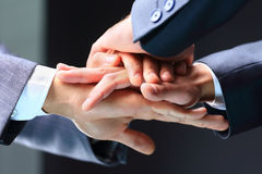 Business partners making pile of hands at meeting Royalty Free Stock Image