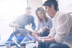 Business partners meeting concept.Coworkers team working new startup project at modern office.Analyze business documents. Using touch tablet.Blurred background stock images