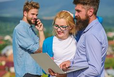 Business partners meeting non formal atmosphere. Colleagues with laptop work outdoor sunny day, nature background. Colleagues pay attention screen laptop while royalty free stock photo