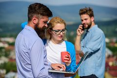 Business partners meeting non formal atmosphere. Colleagues pay attention screen laptop while man talking phone. Business partners meeting non formal atmosphere royalty free stock photo