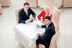 Business partners at the meeting. Top view of the Three business Royalty Free Stock Photography
