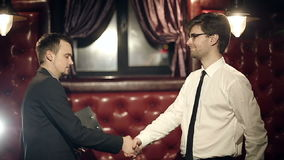 Business partners men doing a handshake. Slow motion. Close up stock footage