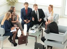 Business partners negotiate in the presence of a business team. Stock Image