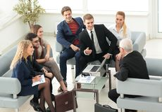 Business partners negotiate in the presence of a business team. Royalty Free Stock Photos