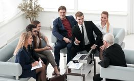 Business partners negotiate in the presence of a business team. Photo with copy space royalty free stock images