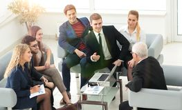 Business partners negotiate in the presence of a business team. Photo with copy space stock photography