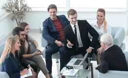 Business partners negotiate in the presence of a business team. Photo with copy space stock photos