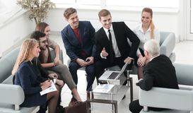 Business partners negotiate in the presence of a business team. Stock Photos