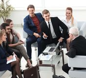 Business partners negotiate in the presence of a business team. Photo with copy space stock image