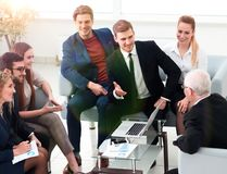 Business partners negotiate in the presence of a business team. Photo with copy space royalty free stock photo