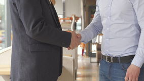 Business partners offer to each other to take place at the cafe stock video footage