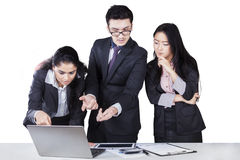 Business partners planning work with laptop Royalty Free Stock Image