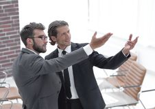 Business partners pointing at blank space Stock Photography