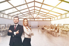 Business partners portrait. Business partners in attic office with rows of computer tables. Concept of successful business. 3d rendering. Mock up. Toned image Royalty Free Stock Photography
