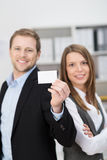 Business partners presenting their business card Royalty Free Stock Photography