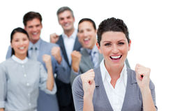 Business partners punching the air in celebration Stock Photo