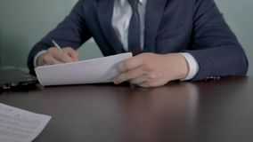 Business Partners Put Signature On Documents And Seal Transaction With Handshake. Close up of the negotiating table in the office where the hands of business stock video footage