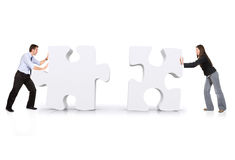 Business partners putting puzzle together Royalty Free Stock Photography