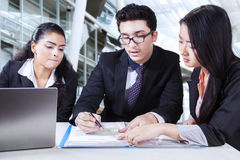 Business partners reading business contract Stock Photography